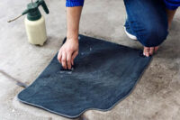 details-of-automobile-cleaning-male-using-professional-chemical-solutions-to-clean-car-floor-mats.jpg