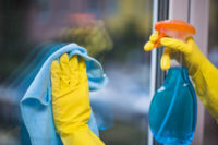 janitor-with-yellow-gloves-cleaning-glass-window_23-2147860451.jpg